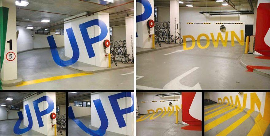Парковка Эврика-Тауэр в Мельбурне, Австралия. Слово только кажется трехмерным